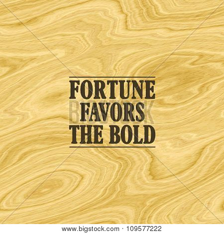 Short inspirational quote about fortune, boldness and success, pictured on wood