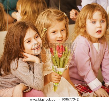 three little diverse girls at birthday party having fun