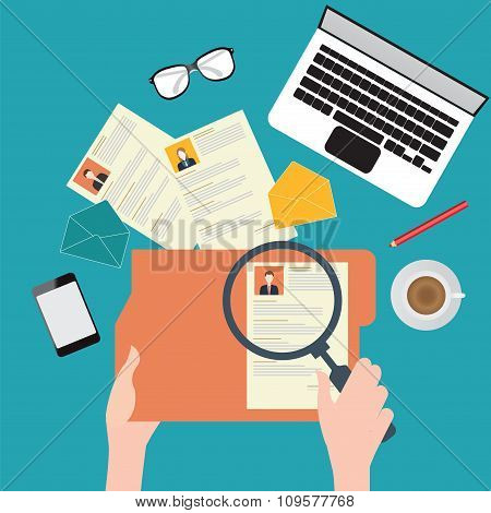 Magnifying glass searching business people
