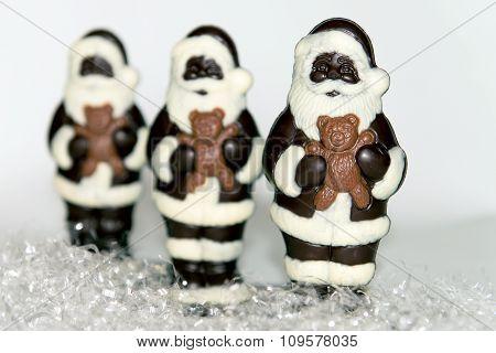 Trio Of Chocolate Santas On Snow