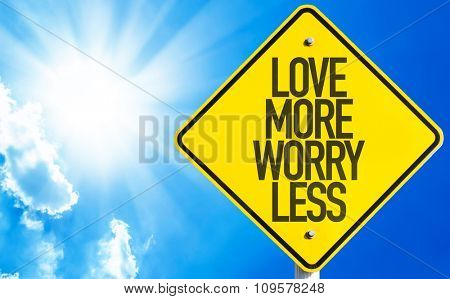 Love More Worry Less sign with sky background