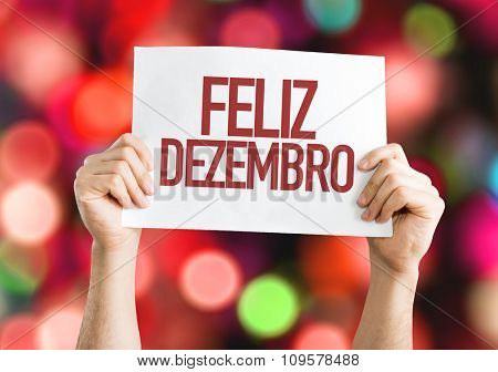 Happy December (in Portuguese) placard with red bokeh background