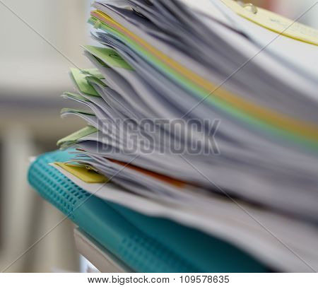 Pile Of Documents And Blue File
