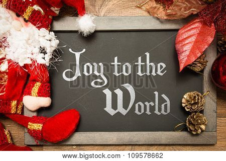 Blackboard with the text: Joy to the World in a christmas conceptual image