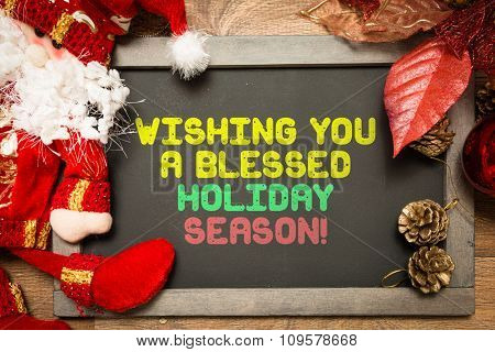 Blackboard with the text: Wishing You a Blessed Holiday Season
