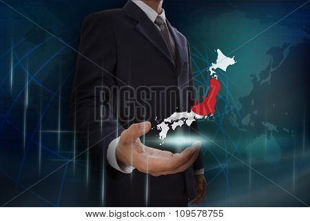 Businessman showing map of Japan on globe background