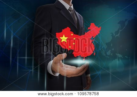 Businessman showing map of China on globe background