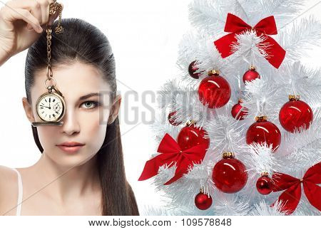 portrait of attractive  caucasian woman brunette isolated on white studio shot with watch time christmas tree new year