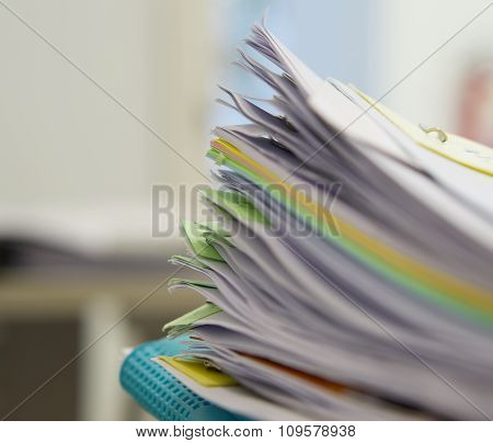 Pile Of Documents And Blue File In Office Background