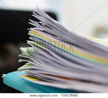 Pile Of Documents And Blue File In Office