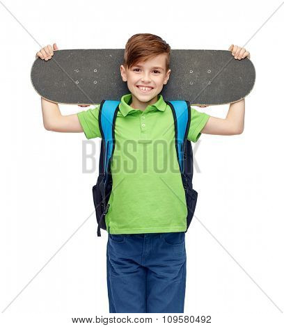 childhood, leisure, school and people concept - happy smiling student boy with backpack and skateboard