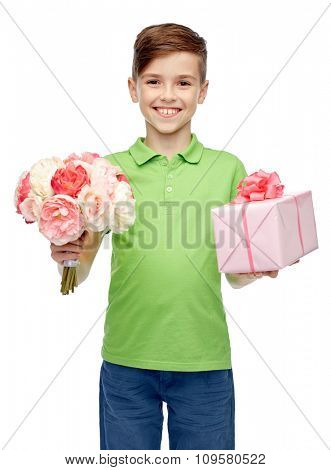 childhood, holidays, presents and people concept - happy boy holding flower bunch and gift box