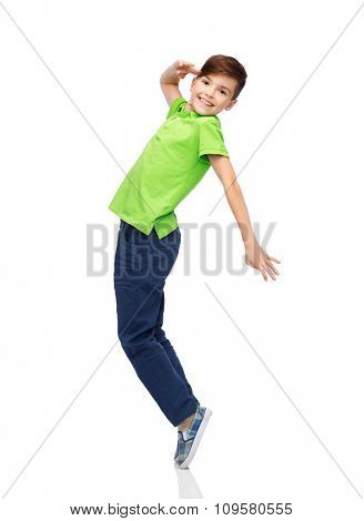 happiness, childhood, freedom, movement and people concept - smiling boy having fun or dancing