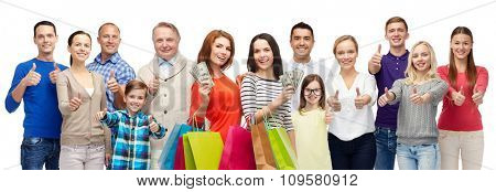 gesture, sale, shopping and people concept - group of smiling men, women and kids showing thumbs up and holding shopping bags with money