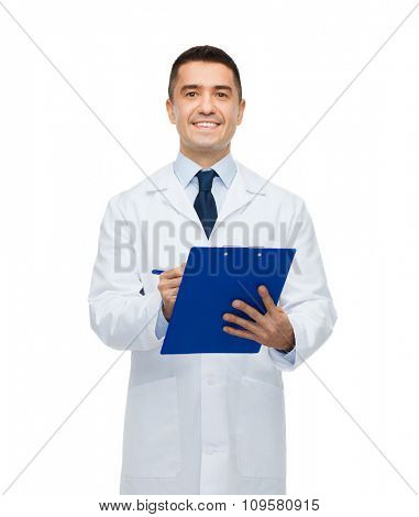 medicine, profession and healthcare concept - smiling male doctor with clipboard writing prescription