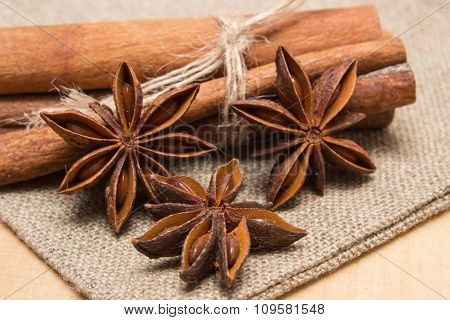 Star Anise And Cinnamon Sticks On Wooden Table, Seasoning For Cooking