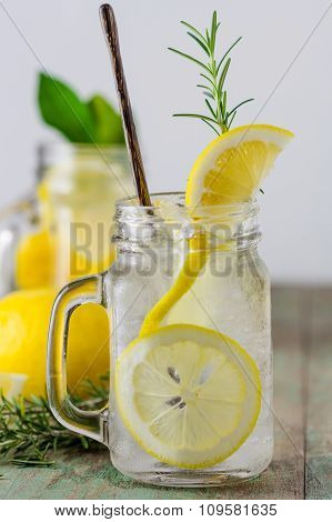 Lemonade With Fresh Lemon And Rosemary In Glass