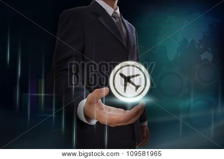 Businessman showing travel icon sign on screen. business concept