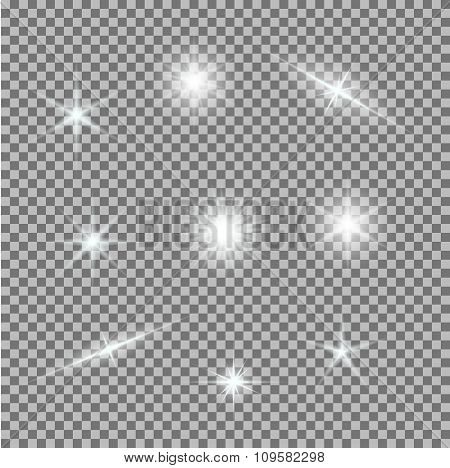 Vector set of glowing light bursts on grey white
