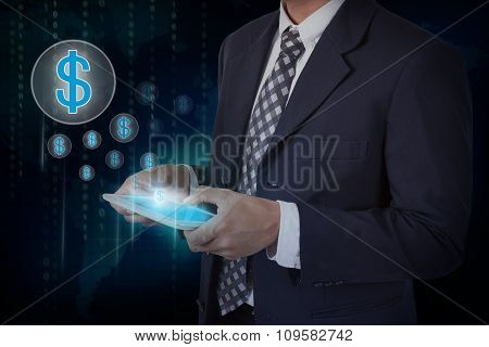 Businessman hand touch screen dollar sign icons on a tablet.