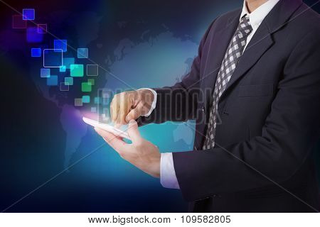 Businessman pushing on a touch screen interface on a tablet