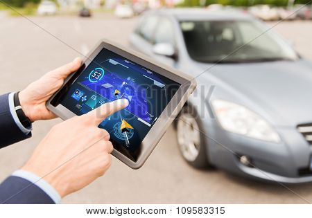 transport, business trip, navigation, technology and people concept - close up of male hands with navigator tablet pc computer and car outdoors