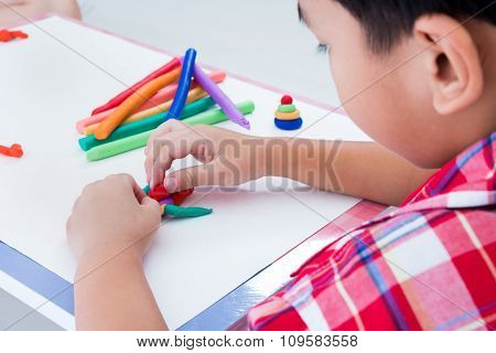 Child Moulding Whale Modeling Clay, On White Background. Strengthen The Imagination