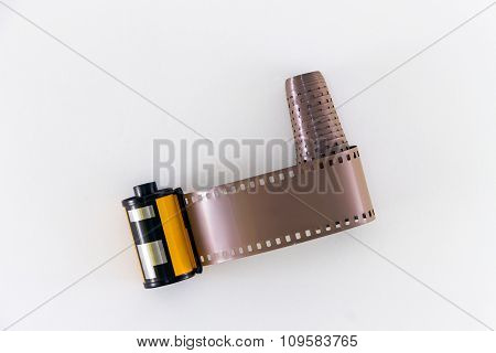 Photo Film In Cartridge On White Background