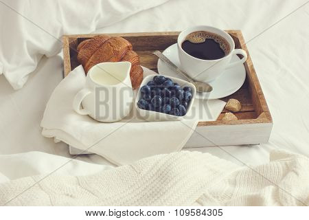 Cup Of Coffee, Croissant And Fresh Blueberry On Wooden Tray, Breakfast In Bad