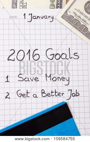 New Years Resolutions Written In Notebook, Currencies Dollar And Credit Card