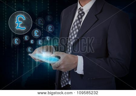 Businessman hand touch screen pound currency symbol on a tablet.