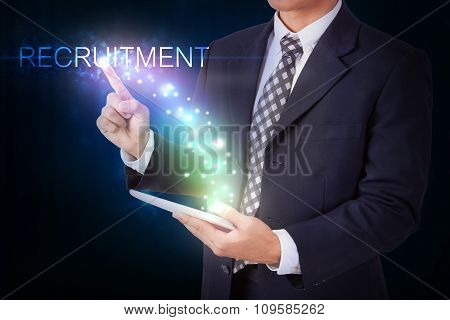 Businessman holding tablet with pressing recruitment sign. internet and networking concept