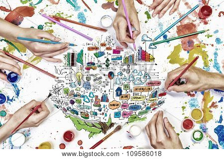 Top view of people hand drawing business creative concept with paints