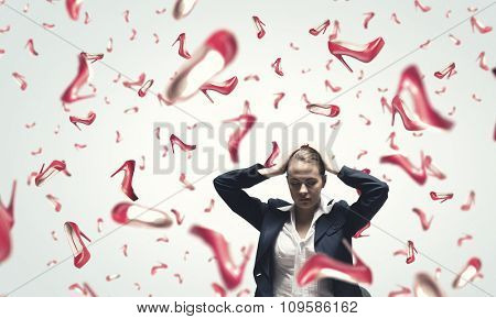 Beautiful young woman in suit and falling shoes