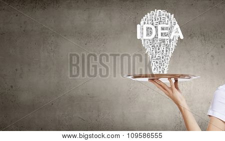 Hand of woman holding tray with successful idea concept