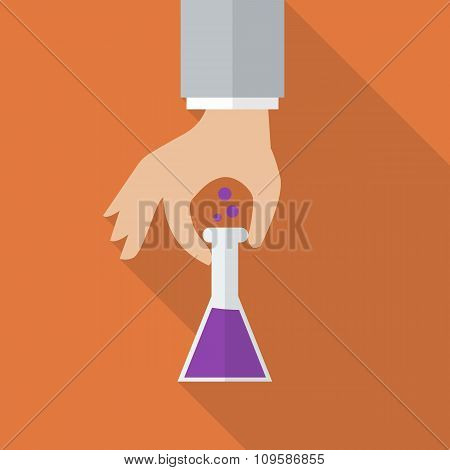 Hand Holding Chemistry Bulb