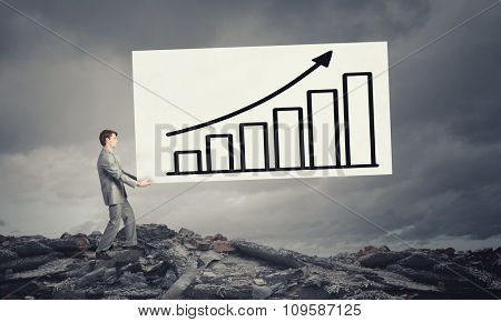 Businessman carrying white banner with graph growth concept