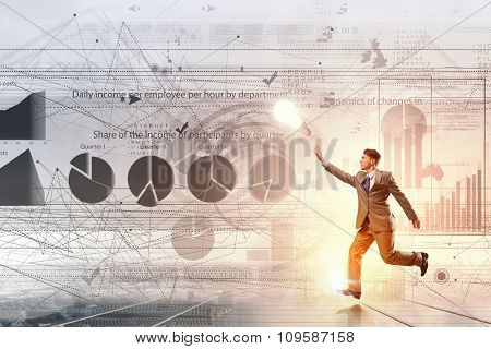 Young businessman running and tryinhg to catch up with something