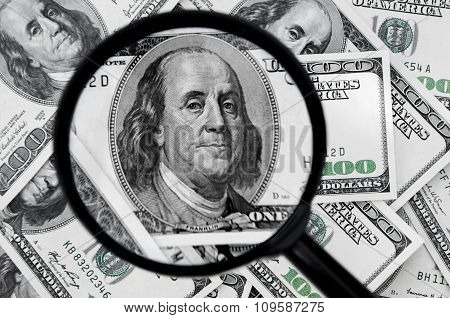 Hundred Dollar Bills And Magnifying Glass