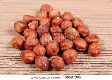 Heap Of Brown Hazelnut On Wooden Table