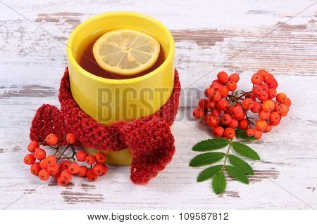Cup Of Tea With Lemon Wrapped Woolen Scarf, Warming Beverage For Flu, Autumn Decoration