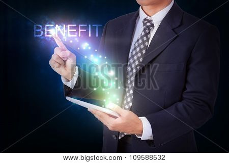 Businessman holding tablet with pressing benefit. internet and networking concept