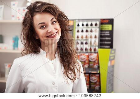 Pharmaceutist Smiling At Clients