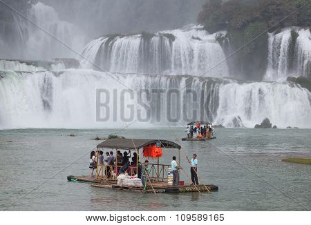 Tourist visit and charm Ban Gioc waterfall on paddling boat