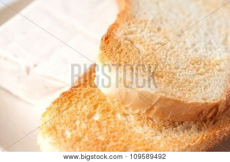 Blurred Background With Two Champagne Glasses And A Piece Of Cheese Close-up