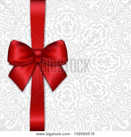 Shiny Holiday Red Satin Ribbon Bow On White Lacy Ornamental  Background. Vector Template For Greetin