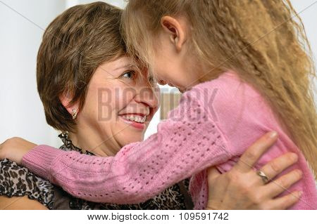 Portrait of happy grandmother and granddaughter
