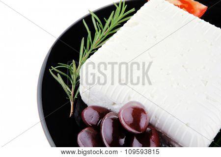 image of feta cube on black plate