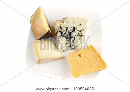 soft delicatessen cheeses on white ceramic plate