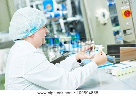 pharmaceutical factory woman worker packing drugs at pharmacy industry manufacture factory